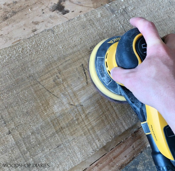 Using sander to sand rough sawn board