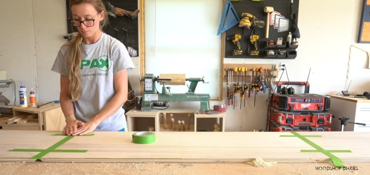 Applying painters tape to miter joints for desk glue up