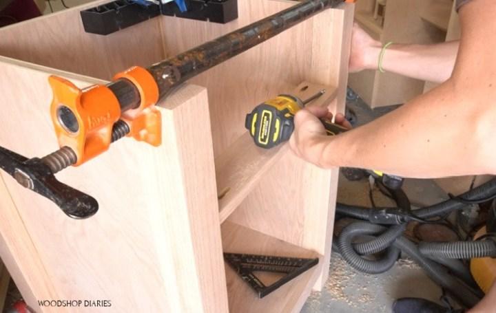 Installing drawer divider into desk cabinet