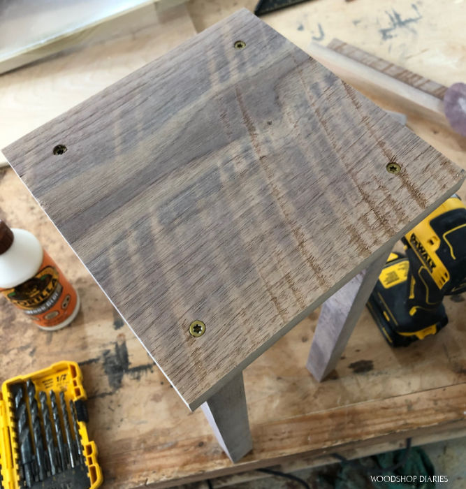 Attach wooden candle lantern posts onto bottom panel with screws