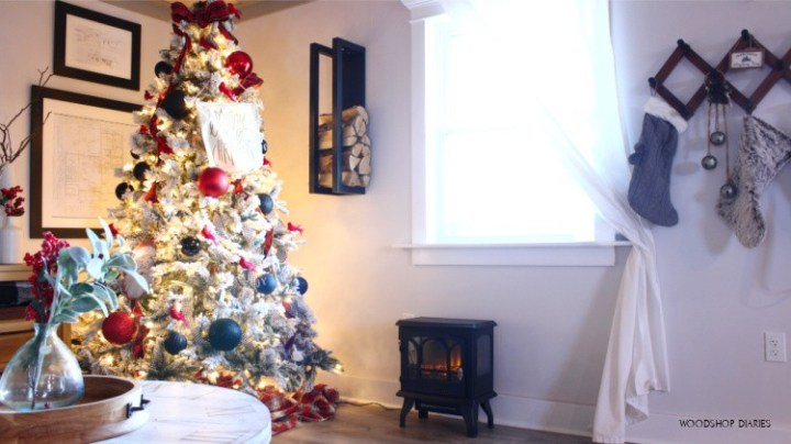 Firewood rack hanging next to Christmas tree above fireplace
