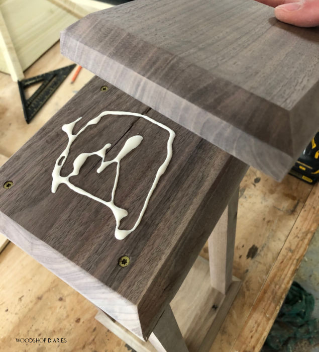 Glue decorative top plates onto scrap wood lantern