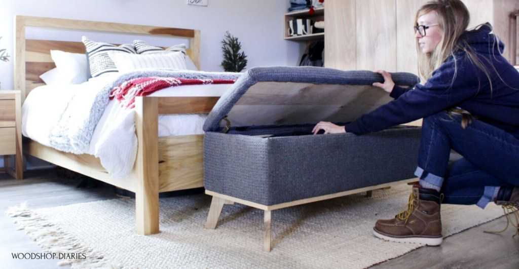 Shara Woodshop Diaries reaching into upholstered storage bench with lid open