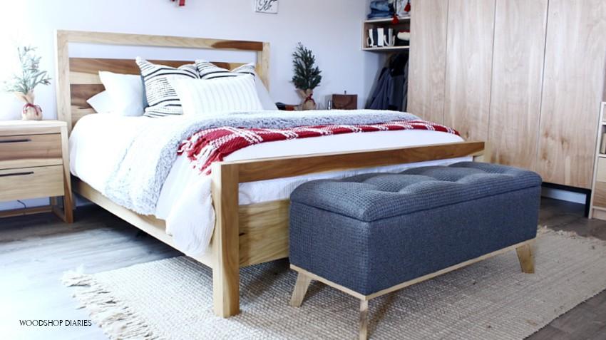 Modern DIY upholstered storage bench at end of bed