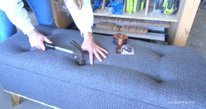 Using a hammer to tuft upholstered bench top seat