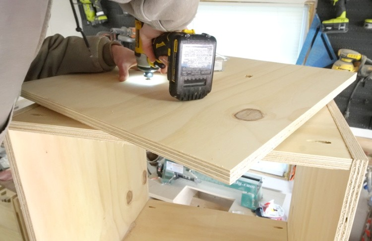 Drilling through access holes in lazy susan to attach onto cabinet bottom