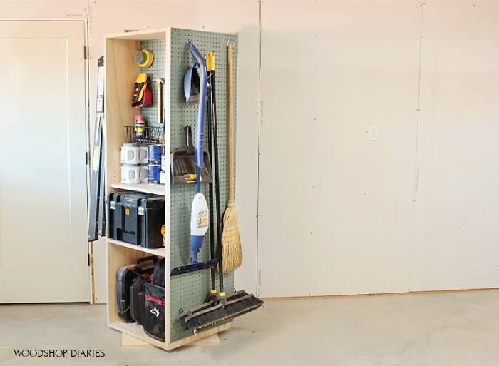 Pegboard on the side of DIY garage storage cabinet