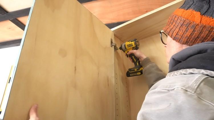 Installing door onto DIY garage cabinet