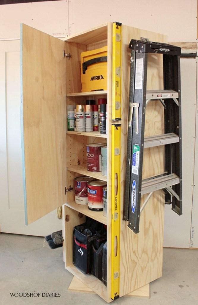 Garage cabinet with door open--storing paint cans inside