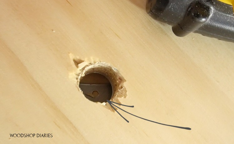 Access holes on base plate of lazy susan cabinet
