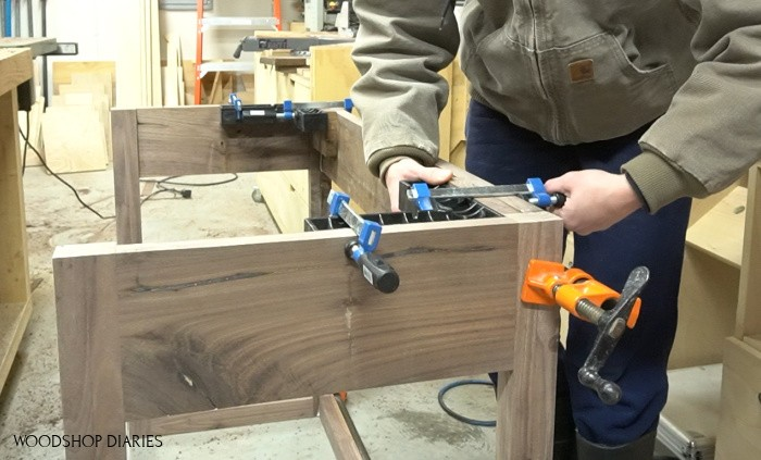 Using corner clamps to secure glue up