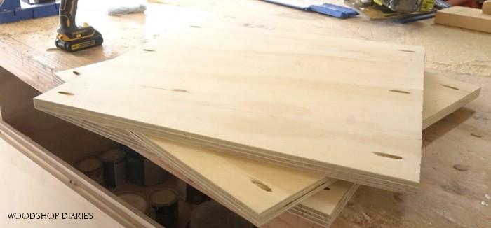 pocket holes drilled into ends of shelf panels for garage organization cabinet