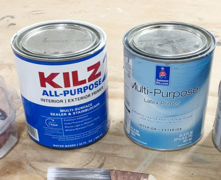 Close up of two primer cans--one Kilz 2 and the other Sherwin Williams Multi-Purpose