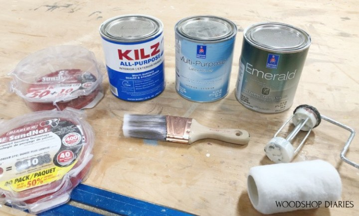 Materials needed to paint raw wood furniture--primer, paint, roller, brush, and sandpaper