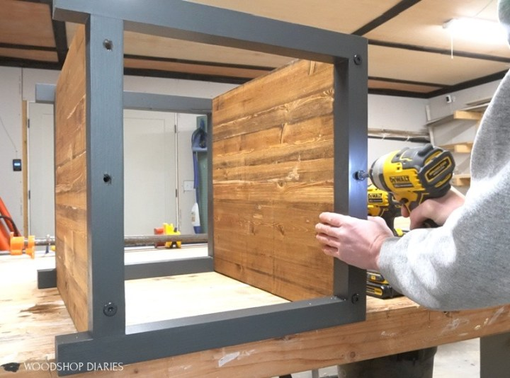 Shara Woodshop Diaries driving timber screw through end table frame to attach top shelf