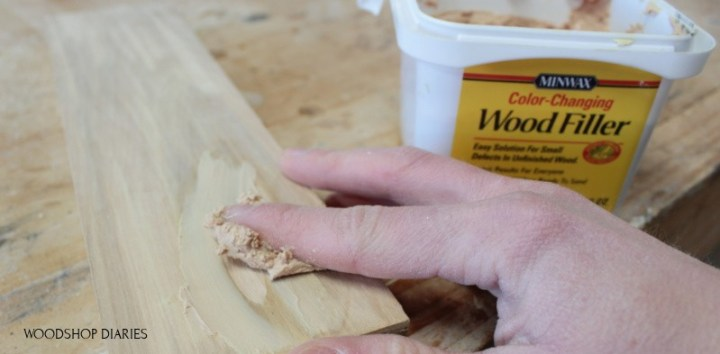 Applying first coat of wood putty to fill pocket hole