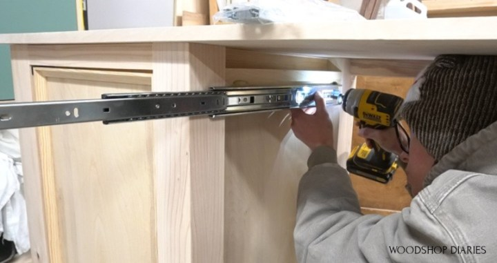 Shara Woodshop Diaries installing drawer slides into center of desk