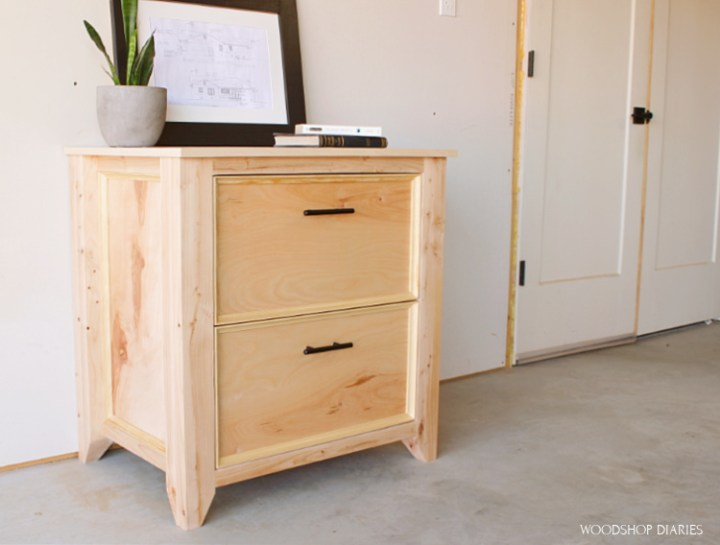 DIY file cabinet built from plywood and 2x4s with clear natural finish and modern black handles
