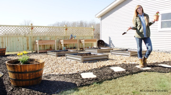 Shara Woodshop Diaries in new garden with privacy fence in back