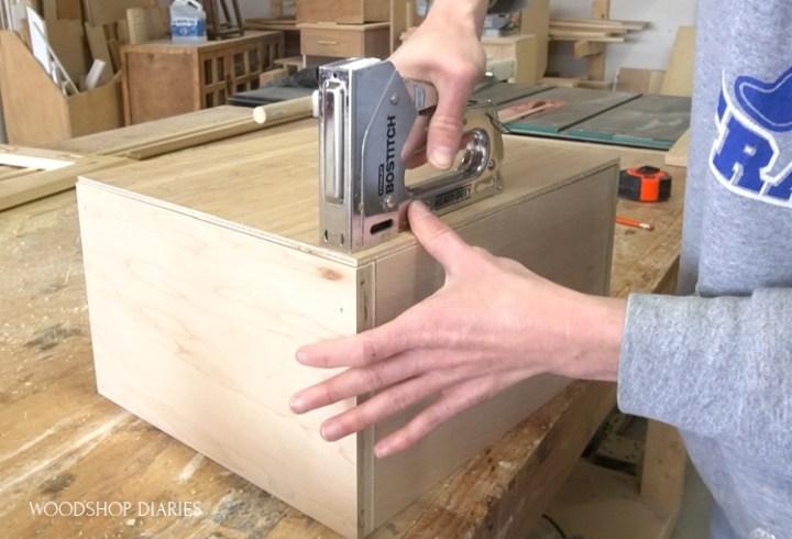"using staple gun to install 1/4"" plywood drawer bottom into drawer box"
