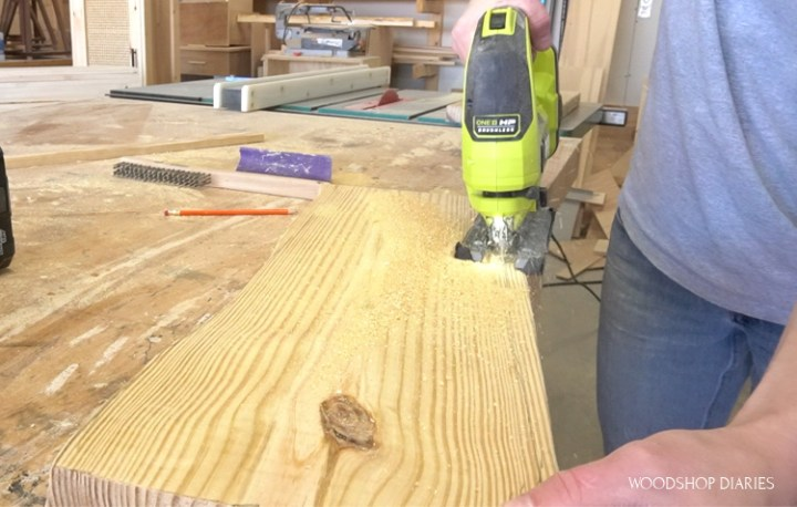 Shara Woodshop Diaries using Ryobi jig saw to cut a fake live edge onto 2x10 board