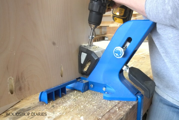 Using a drill to drill pocket holes into plywood panel with Kreg 720
