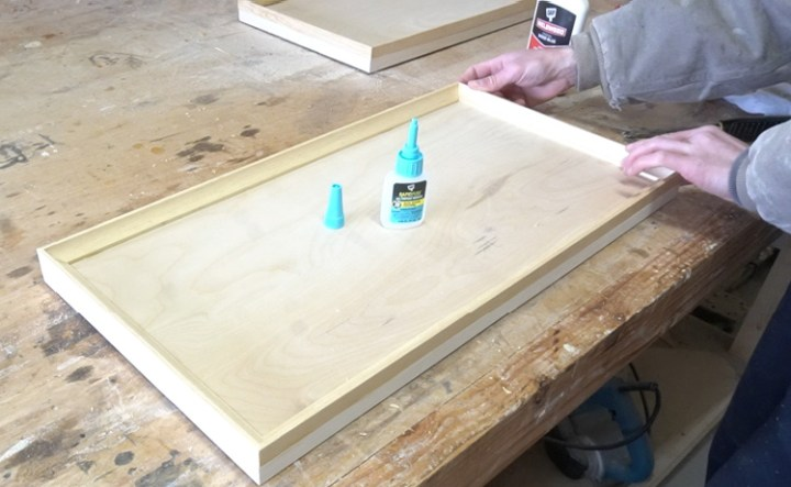 Shara using Rapid Fuse to secure cove trim around drawer front edges