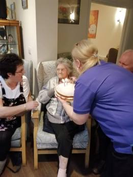 Joan receives her cake