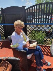 Tricia didn't take part in the gardening, deciding to read her book instead