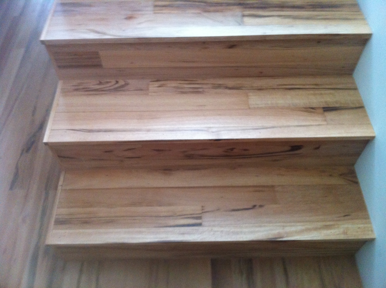 Stair Treads Using Flooring Stair Parts Blog   Stairs Covered In Wood   Simple   Wood Paneling   Glass   Rustic   White