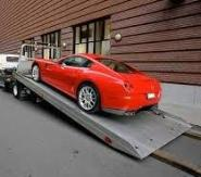 rec sports car being towed