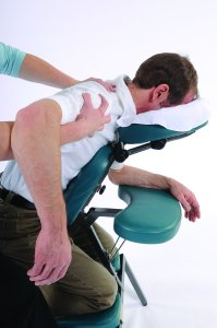 Man receives chair massage at his place of work from Spa-2-Go mobile massage therapist from Woodstown Massage Botuique