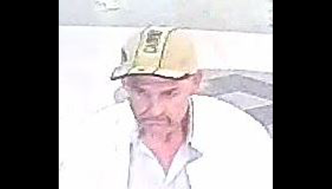 A surveillance photo of a suspect accused of a larceny in Kalamazoo. (Courtesy of Kalamazoo Department of Public Safety)