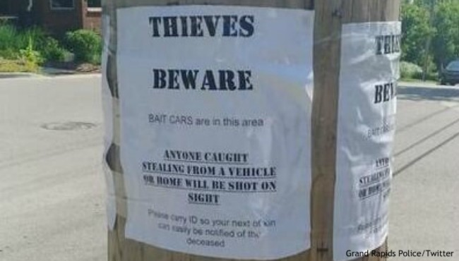 Thieves beware flyer posted on utility pole