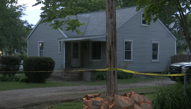 crime tape outside Lansing home where remains were found