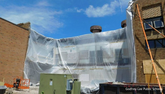 tarp covers open part of high school building