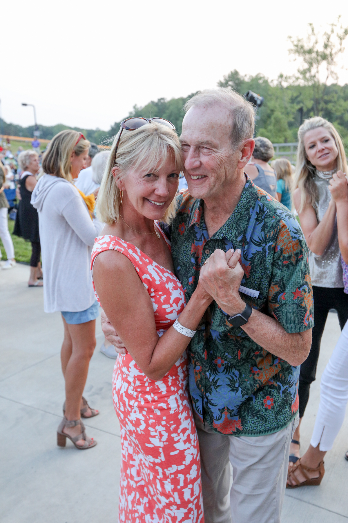 People relaxed and danced as they listened to music at Picnic Pops at the Cannonsburg Ski Area. (July 25, 2019)
