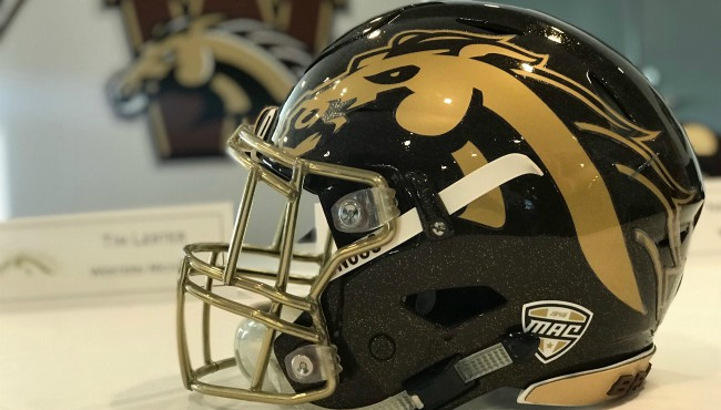 Display helmet with Western Michigan University logo sits on table