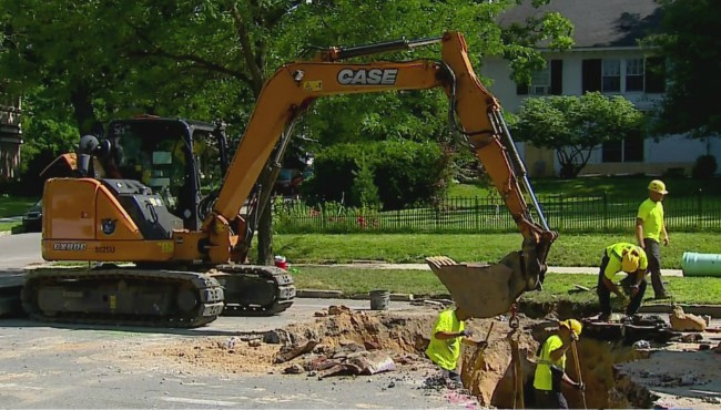 Excavator digs Lake Drive SE in Grand Rapids
