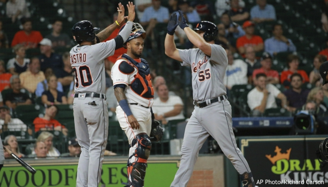 Detroit Tigers' John Hicks, right, is greeted at home after driving in teammate Harold Castro, left, on a pinch-hit two-run home run as Houston Astros catcher Martin Maldonado, center, looks on in the ninth inning of a baseball game Thursday, Aug. 22, 2019, in Houston. (AP Photo/Richard Carson)