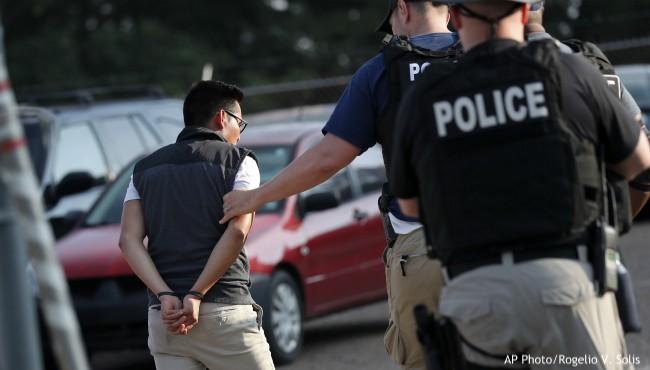 Man escorted away in handcuffs