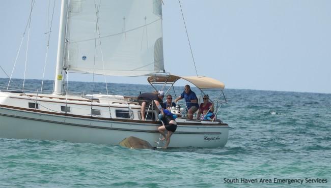 People board sailboat on Lake Michigan
