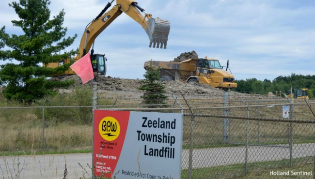 Excavator digs at Zeeland Township landfill
