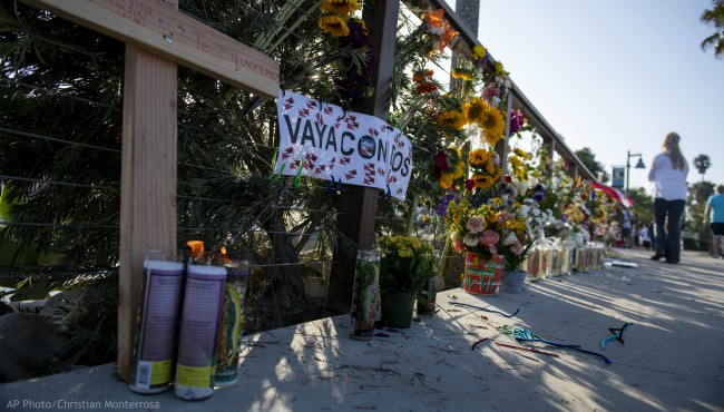 "A wooden cross and a sign that reads ""Go With God"" in Spanish are displayed at a memorial site for the victims of the diving boat Conception on Tuesday, Sept. 3, 2019, in Santa Barbara, Calif."