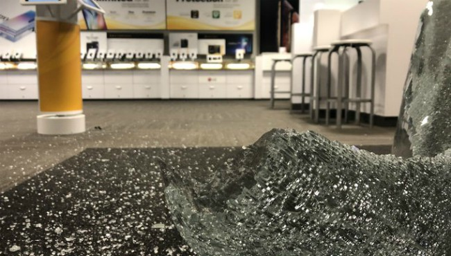 Shattered glass at the Sprint Store in Kentwood Tuesday, Sept. 10, 2019.