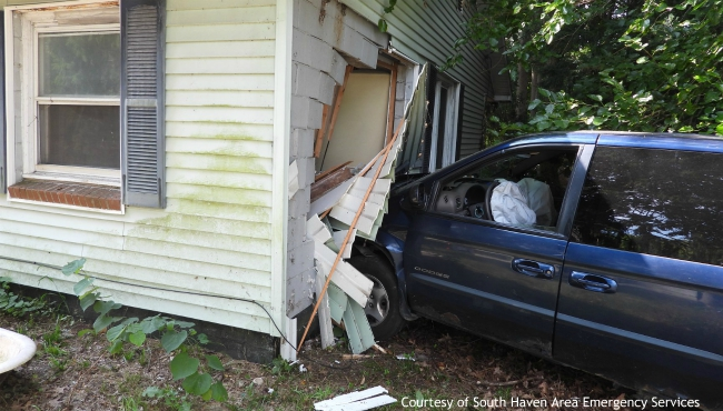 A photo of a vehicle crashed into a South Haven Township home. (Courtesy of South Haven Area Emergency Services)