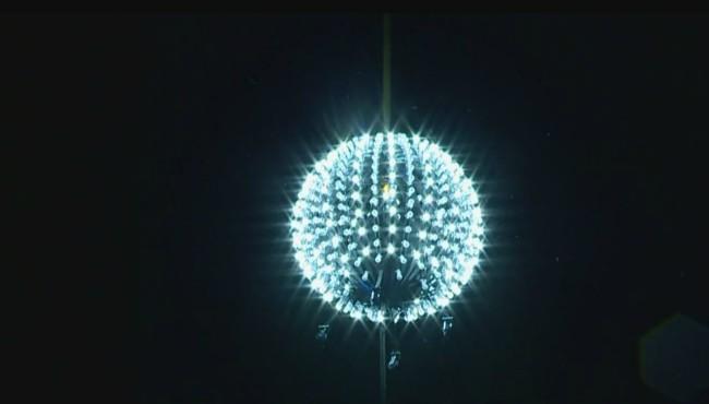 lit ball descending down pole