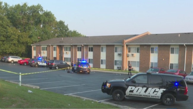 crime tape in front of apartment complex