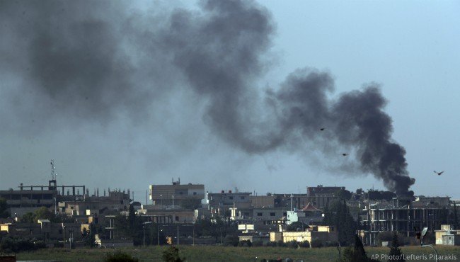 In this photo taken from the Turkish side of the border between Turkey and Syria, in Akcakale, Sanliurfa province, southeastern Turkey, smoke billows from targets in Tel Abyad, Syria, during bombardment by Turkish forces, Friday, Oct. 11, 2019. (AP Photo/Lefteris Pitarakis)