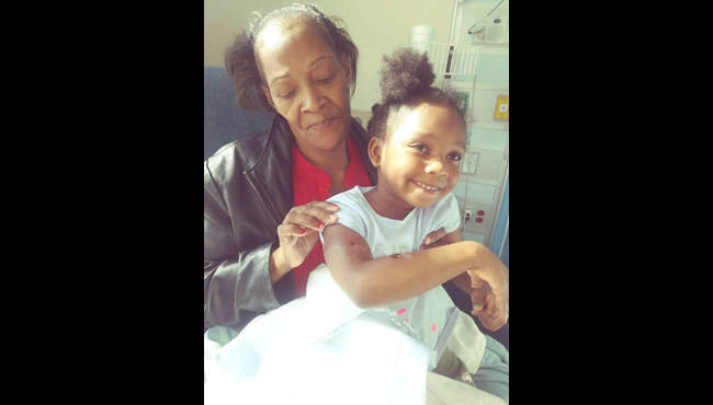 A courtesy photo of Kaliesia with her grandmother in the hospital.